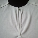 обработка застежки поло в футболках